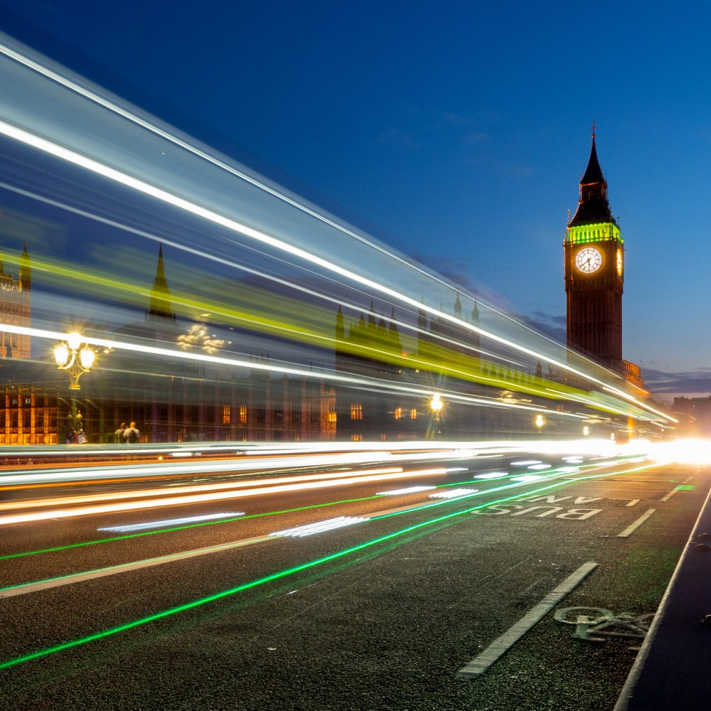 Big Ben and the Palace of Westminster at night with light trails